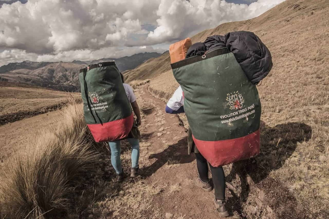 Female Inca Trail porters with packs