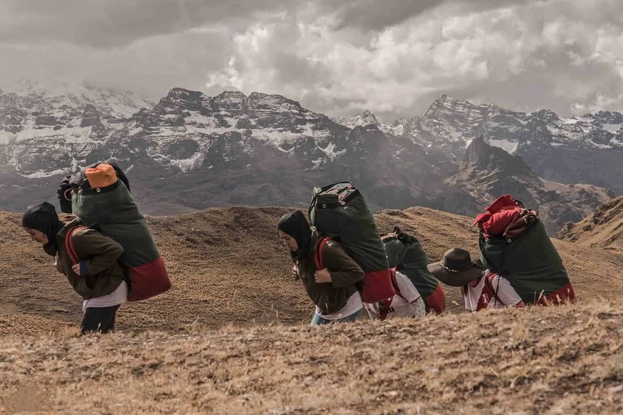 Fenale porters carrying their packs on on the Inca Trail